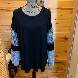 Black sweater with pattern sleeves